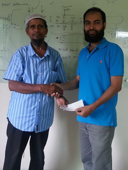 Nascenia making a donation to Anjuman-E-Mufidul Islam