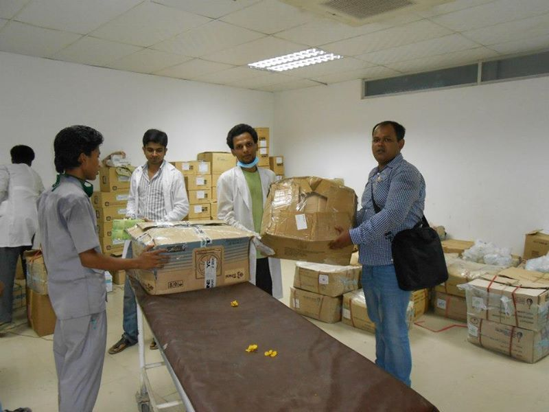 Handing over medicine at Enam Medical