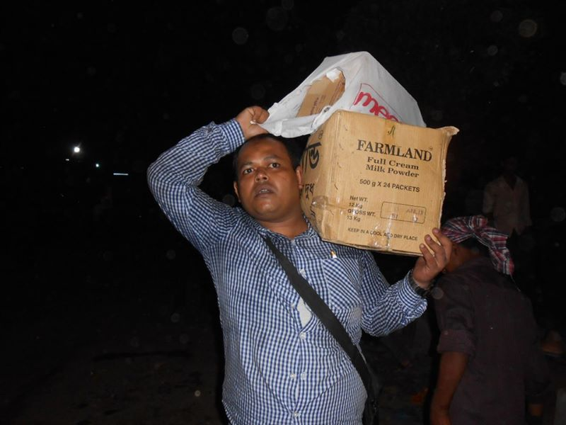 Jony, carrying food and water for volunteers at spot