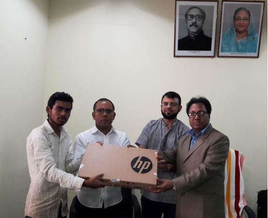 Giving laptop to Abid Afsan Hamid | A little contribution to make a big difference